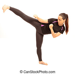 Karate Kick - A young female dressed in gym clothes...