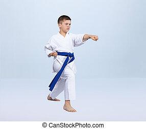 Karate kick athlete is beating