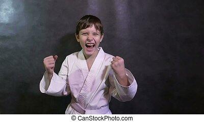 Karate kid boy screaming success teenager victory rejoices -...