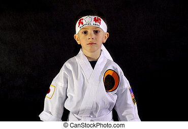 Karate Kid - Child Wearing Karate Outfit (Gee). Logos...