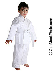 Karate Kid - Four year old boy dressed in karat gi uniform...