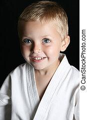 Karate Kid - Blond boy with blue eyes in karate uniform