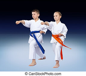 Karate kids are beating punch arm