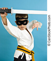 Karate Ninja - A child dressed in a makeshift costume for...