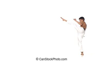 Karate or taekwondo makes a somersault through itself. Slow...