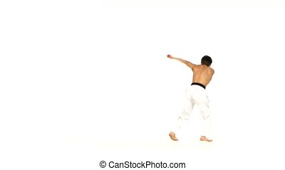 Karate or taekwondo man makes several hops around you -...