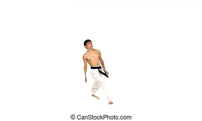 karate or taekwondo training, performs complex exercise