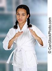 Karate - Teen girl doing karate at a studio