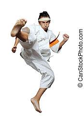 Karate - Boy in martial arts uniform doing karate