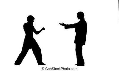 Karate with taekwondo makes several hops around you, Silhouette