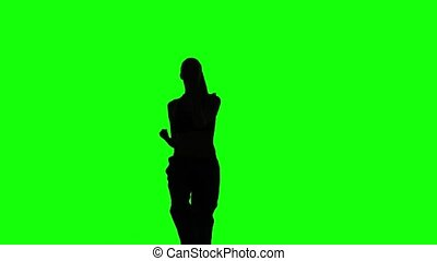 Karate woman practicing moves in karate. Green. Silhouette -...