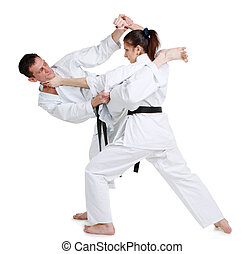 Karate. Young girl and a men in a kimono. Battle sports...