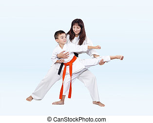 Karateka beats kicking trainer corrects