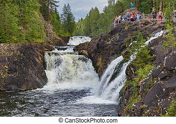 Karelia, Russia - August 01, 2020: Tourists on Kivach waterfall in Karelia Russia