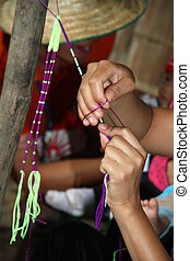 Traditional braiding in Karen tribal village, Chiang Mai, Thailand
