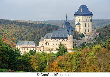 Karlstejn Castle in beautiful autumn colored landscape with...