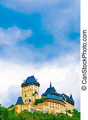 Karlstejn castle on green hill, Prague, Czech Republic