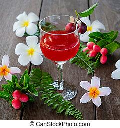 Karonda Fruit juice in glass on wood table