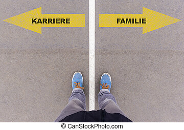 Karriere / Familie, German text for career or family on asphalt ground, feet and shoes on floor