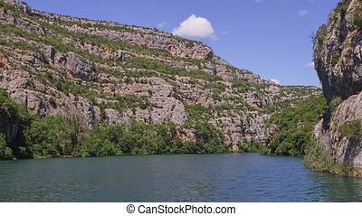 Karst nature of the Krka River canyon on summer day,...