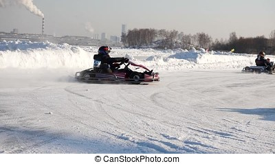 Kart racing on the frozen lake. Winter cart. Riding a go...