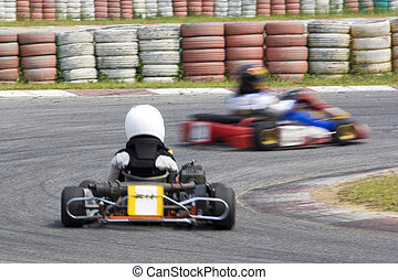 Karting Action (Blurred) - Image of go-kart racers competing...