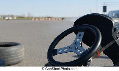 Karting competitions, kart racing steering wheel close-up,...