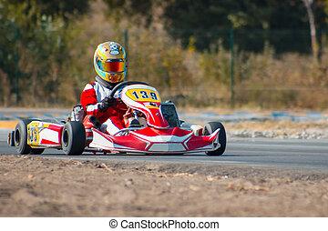 Karting - driver in helmet on kart circuit - Karting -...