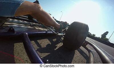 Karting driver rushes recreational go-kart crosses finish line on kart track