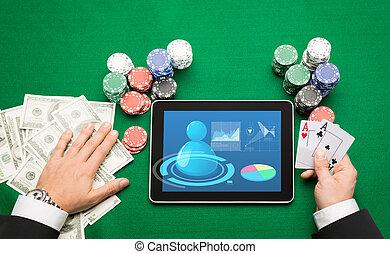 kasino, feuerhaken, spieler, mit, karten, tablette, und, späne