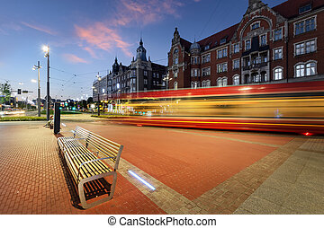 Katowice and tram light trails during sunset