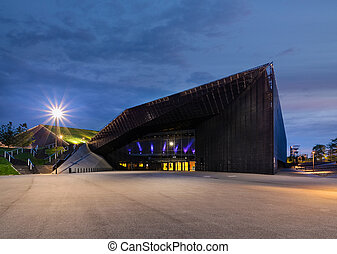 KATOWICE, POLAND -JULY 26, 2017: International Convention Centre in Katowice in the evening with spodek in reflection on July 26, 2017. Structure is one of the best recognizable landmark of the city.