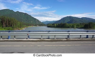 Katun River view from car moving across the bridge - Katun...