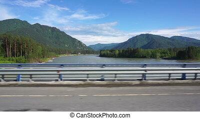 Katun River view from car moving across the bridge - Katun...