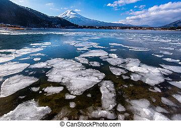 Kawaguchiko lake is ice in winter Mt. Fuji background, ...