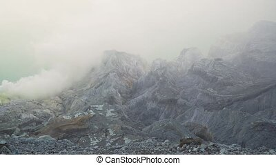 Kawah Ijen, Volcanic crater, where sulfur is mined. -...