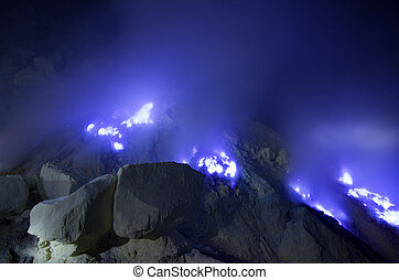 Kawah Ijen volcano, East Java - blue sulfur flames. - Kawah...