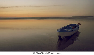 kayak photo in the beach after sunset