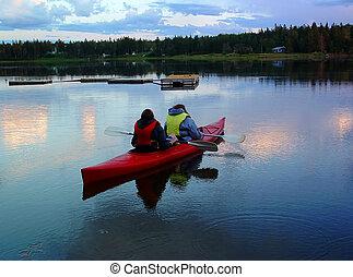 Kayak 05 - Two women kayaking on a calm river at sunset