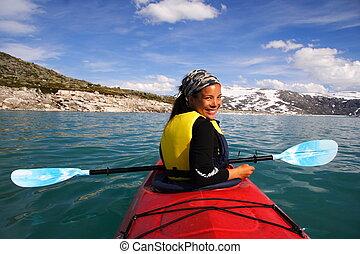 Kayak at glacier lake, Styggevatnet, Jostedalsbreen in Norway. Summer.
