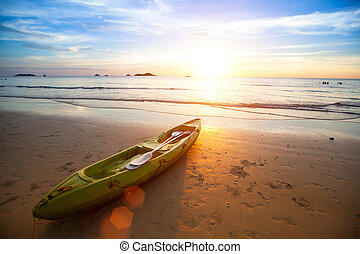 Kayak at the tropical beach at beautiful sunset.