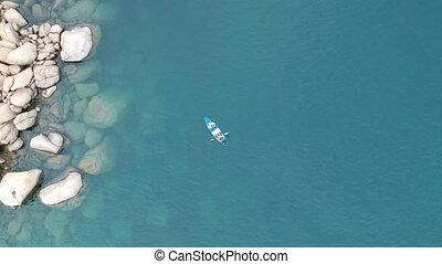 Kayak in Blue Sea Overhead Aerial - Overhead aerial of kayak...