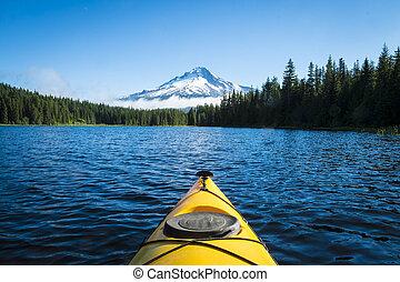 Kayak in mountain lake, Mt. Hood, Oregon