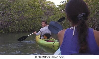 Kayak - Kayaking friends on kayaking travel adventure in ...