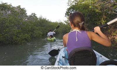Kayak - Kayaking woman on kayaking travel adventure in ...