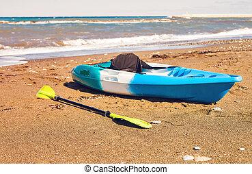 kayak lies on the sand