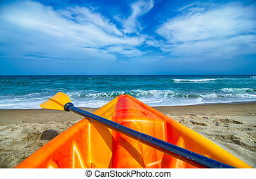 kayak looking at the beach and ocean waves