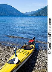 Kayak on glacier lak - Crescent Lake in Olympic National...