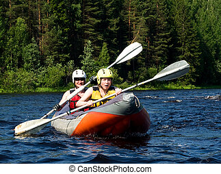 Kayak on river - Kayakers sporting a kayak cuts through ...