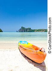 Kayak on the beach with blue sky